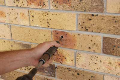 Using a special tool the helical remedial tie is inserted locking both brick leaves together